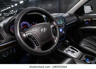Novosibirsk, Russia – July 31, 2019:  Hyundai Santa Fe, close-up of the dashboard, speedometer, tachometer and steering wheel. . modern car interior
