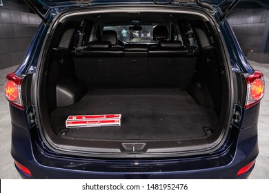 Novosibirsk, Russia – July 31, 2019:  Hyundai Santa Fe, close-up of the open trunk, front view. Photography of a modern car on a parking in Novosibirsk