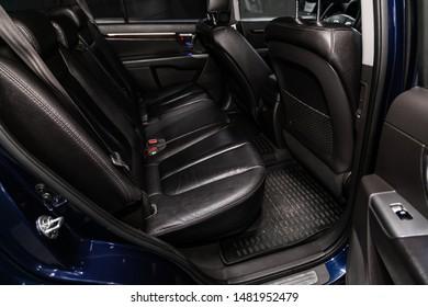 Novosibirsk, Russia – July 31, 2019:  Hyundai Santa Fe, close-up of the black  leather rear seats with seats belt. modern car interior