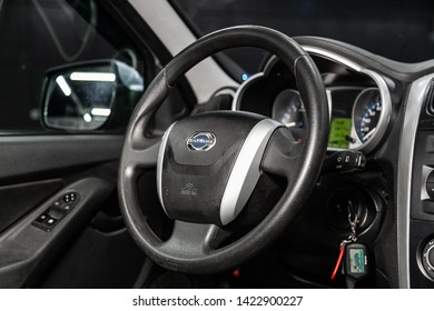 Novosibirsk, Russia – June 11, 2019:  Datsun on-DO, close-up of the dashboard, speedometer and tachometer with white backlight. modern car interior