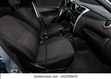 Novosibirsk, Russia – June 11, 2019:  Datsun on-DO, close-up  dashboard, adjustment of the blower, air conditioner, player, steering wheel, seats, accelerator handle and buttons. modern car interior