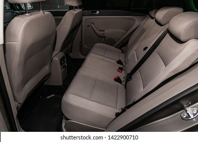 Novosibirsk, Russia – June 11, 2019:  Volkswagen Golf+, close-up of the gray rear seats with seats belt. modern car interior