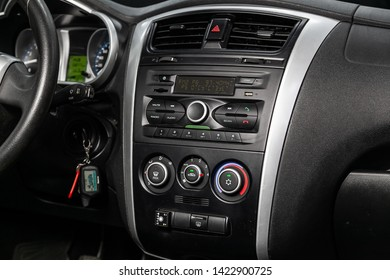 Novosibirsk, Russia – June 11, 2019:  Datsun on-DO, close-up of the dashboard with clock, temperature, adjustment of the blower, air conditioner,radio,  player. modern car interior