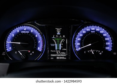 Novosibirsk, Russia – June 11, 2019:  Toyota Camry,  close-up of the dashboard, speedometer and tachometer with blue backlight. modern car interior