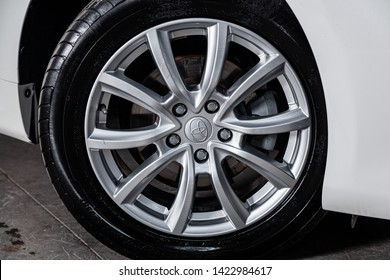 Novosibirsk, Russia – June 11, 2019:  Toyota Camry, close-up of the alloy wheel. Photography of a modern car on a parking in Novosibirsk