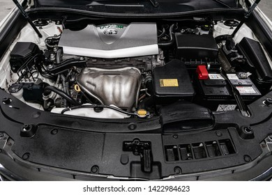Novosibirsk, Russia – June 11, 2019:  Toyota Camry, close-up of the engine, front view. Internal combustion engine, car parts, deteyling