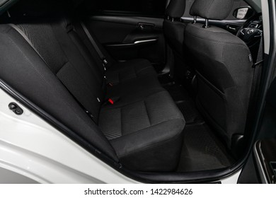 Novosibirsk, Russia – June 11, 2019:  Toyota Camry, close-up of the black  rear seats with seats belt. modern car interior