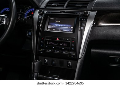 Novosibirsk, Russia – June 11, 2019:  Toyota Camry, close-up of the dashboard, adjustment of the blower, air conditioner, radio, player. modern car interior