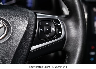Novosibirsk, Russia – June 11, 2019:  Toyota Camry, Car controller on steerling wheel ,Music,Control System Function and voice telephone in car. modern car interior
