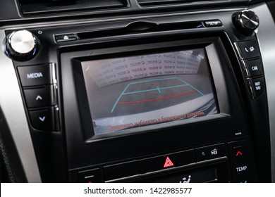 Novosibirsk, Russia – June 11, 2019:  Toyota Camry, , close-up of the reversong camera and buttons. modern car interior