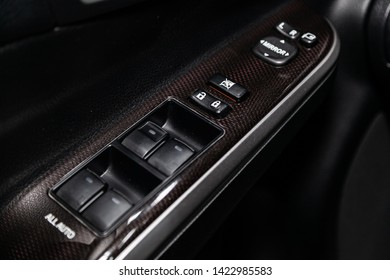 Novosibirsk, Russia – June 11, 2019:  Toyota Camry, close-up of the side door buttons: window adjustment buttons, door lock. modern car interior