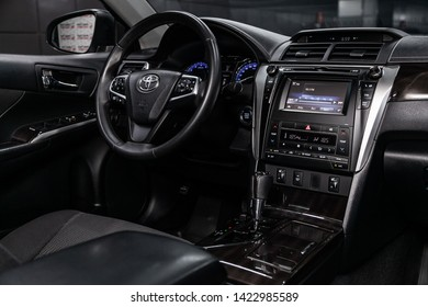 Novosibirsk, Russia – June 11, 2019:  Toyota Camry, close-up of the dashboard, adjustment of the blower, air conditioner, player, steering wheel, seats. modern car interior