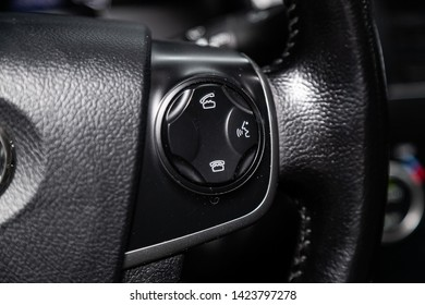 Novosibirsk, Russia – June 11, 2019:  Toyota Camry,  close-up of the Multiwheel with phone setting and volume buttons. Photography of a modern car on a parking in Novosibirsk. modern car interior