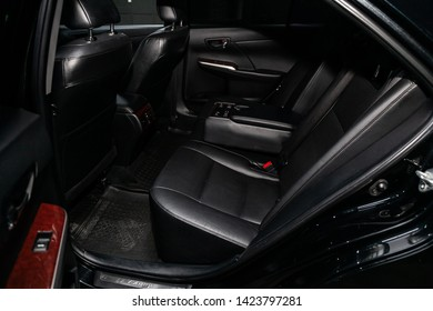 Novosibirsk, Russia – June 11, 2019:  Toyota Camry, close-up of the black  leather rear seats with seats belt. modern car interior