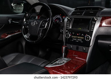 Novosibirsk, Russia – June 11, 2019:  Toyota Camry,  close-up of the dashboard, adjustment of the blower, air conditioner, player, steering wheel,black leather seats. modern car interior