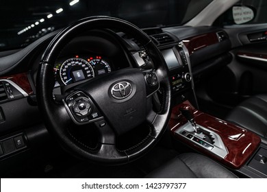Novosibirsk, Russia – June 11, 2019:  Toyota Camry,  close-up of the dashboard, speedometer, tachometer and steering wheel. . modern car interior