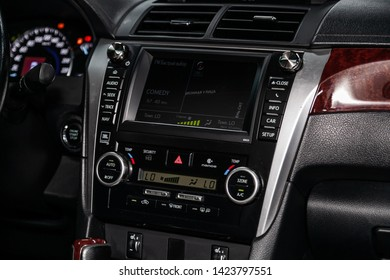 Novosibirsk, Russia – June 11, 2019:  Toyota Camry,  close-up of the dashboard with information about temperature, radio, clock , adjustment of the blower, air conditioner, player. modern car interior