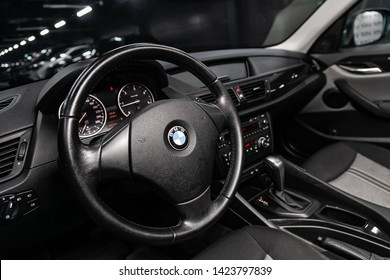Novosibirsk, Russia – June 11, 2019:  BMW X1, close-up of the dashboard, speedometer, tachometer and steering wheel. . modern car interior