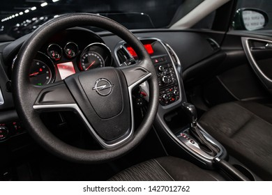 Novosibirsk, Russia – June 14, 2019:  Opel Astra, close-up of the dashboard, speedometer, tachometer and steering wheel. . modern car interior