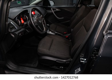 Novosibirsk, Russia – June 14, 2019:  Opel Astra, close-up of the dashboard, adjustment of the blower, air conditioner, player, steering wheel, seats. modern car interior