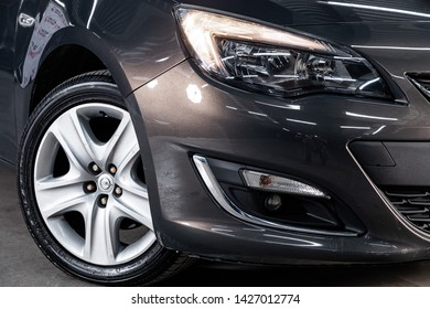 Novosibirsk, Russia – June 14, 2019:  Opel Astra, close-up of the headlight, bumper, wheel. Photography of a modern car on a parking in Novosibirsk