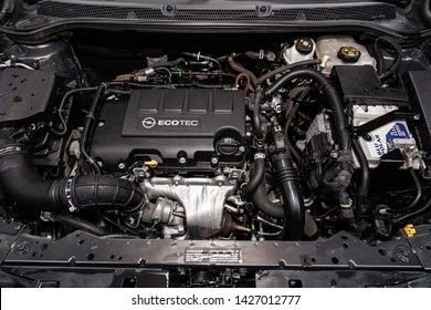 Novosibirsk, Russia – June 14, 2019:  Opel Astra, close-up of the engine, front view. Internal combustion engine, car parts, deteyling