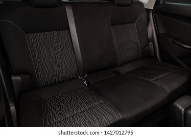 Novosibirsk, Russia – June 14, 2019:  Opel Astra, close-up of the black  rear seats with seats belt. modern car interior