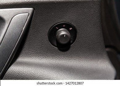 Novosibirsk, Russia – June 14, 2019:  Opel Astra, close-up of the  buttons: side mirror adjustment buttons. modern car interior
