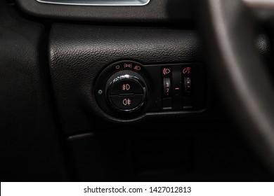 Novosibirsk, Russia – June 14, 2019:  Opel Astra, close-up of the headlight adjustment buttons. modern car interior
