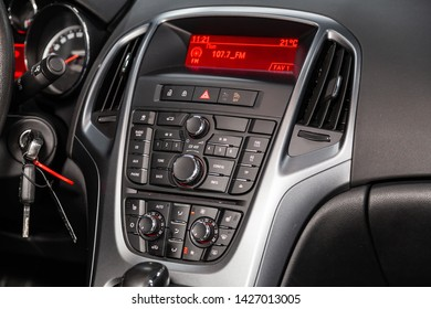 Novosibirsk, Russia – June 14, 2019:  Opel Astra, close-up of the dashboard with information about temperature, radio, clock and other, adjustment of the blower, air conditioner, player. modern car