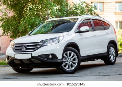 Novosibirsk, Russia -  June 18, 2017: white Honda CRV , side view. Photography of a urban crossover in the street on a summer day
