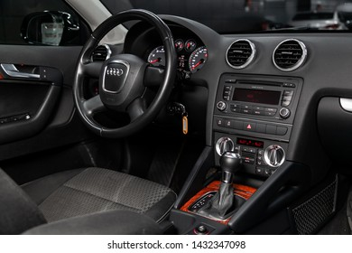 Novosibirsk, Russia – June 18, 2019:  Audi A3, close-up of the dashboard, adjustment of the blower, air conditioner, player, steering wheel, black seats. modern car interior