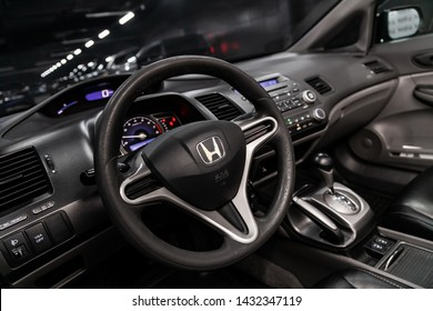 Novosibirsk, Russia – June 18, 2019:  Honda Civic,  close-up of the dashboard, speedometer, tachometer and steering wheel. . modern car interior