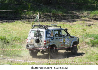 """Novosibirsk, Russia - June 20, 2016, Russian off-road car """"UAZ Patriot"""" in the labels from the competition rides on the field this summer, forests in Novosibirsk on 20 June 2016."""