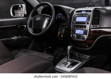 Novosibirsk, Russia – June 22, 2019:  Hyundai Santa Fe, close-up of the dashboard, player, steering wheel, accelerator handle, buttons, seats. modern car interior: parts, buttons, knobs