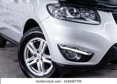 Novosibirsk, Russia – June 22, 2019:  Hyundai Santa Fe, close-up of the headlight, bumper, wheel. Photography of a modern car on a parking in Novosibirsk