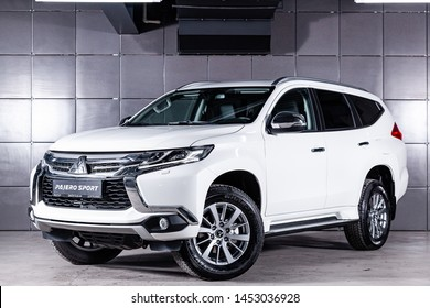 Novosibirsk, Russia – June 30, 2019:  white Mitsubishi Pajero Sport, front view.  Photography of a modern crossover made in Japan on a parking in Novosibirsk