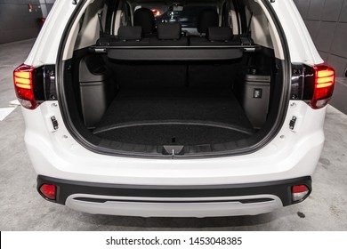 Novosibirsk, Russia – June 30, 2019:  Mitsubishi Outlander, close-up of the open trunk, front view. Photography of a modern car on a parking in Novosibirsk