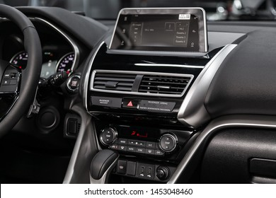 Novosibirsk, Russia – June 30, 2019:  Mitsubishi Eclipse Cross, close-up of the dashboard, adjustment of the blower, air conditioner, player. modern car interior