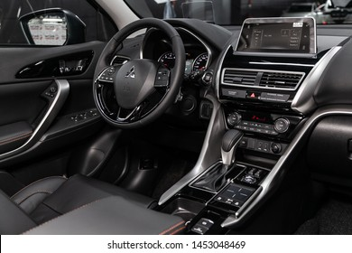 Novosibirsk, Russia – June 30, 2019:  Mitsubishi Eclipse Cross, close-up of the dashboard, player, steering wheel, accelerator handle, buttons, seats. modern car interior: parts, buttons, knobs