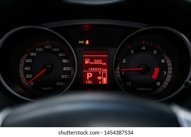 Novosibirsk, Russia – June 30, 2019:  Peugeot 4007, close-up of the dashboard, speedometer and tachometer with white backlight. modern car interior