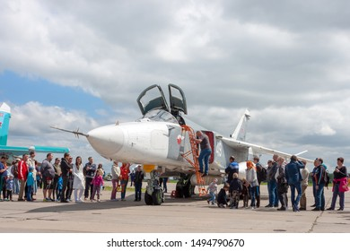"""NOVOSIBIRSK, RUSSIA - JUNE 30, 2019: International military-technical Forum """"ARMY-2019"""". Civilians stand in line to get into the cockpit of a military aircraft"""