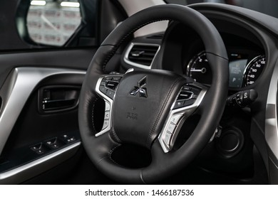 Novosibirsk, Russia – June 30, 2019:Mitsubishi Pajero Sport, close-up of the dashboard, speedometer, tachometer and steering wheel. . modern car interior