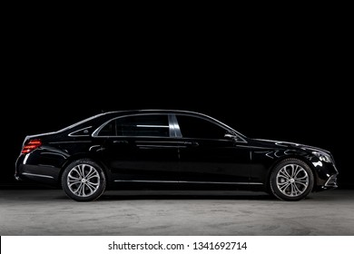 Novosibirsk, Russia - March 15, 2019:  Mercedes Maybach S450 4Matic, side view. Photography of a modern car  on a parking in Novosibirsk against a black wall