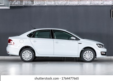 Novosibirsk/ Russia – March 15  2020: white Volkswagen Polo, compact sedan  car parked on black background , side view