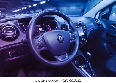 Novosibirsk, Russia – March 16  2021: Renault Kapture,Luxurious car interior - steering wheel, shift lever and dashboard under the pink neon color