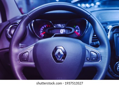 Novosibirsk, Russia – March 16  2021: Renault Kapture, Interior of new modern SUV car with automatic transmission, dashboard under the pink neon color