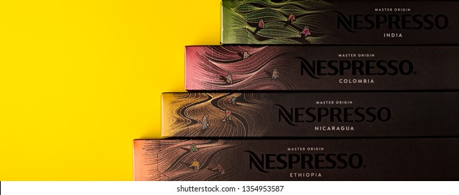 Novosibirsk, RUSSIA March 30, 2019- Nespresso Master Origin Coffee Capsules Packs Limited Collection on a yellow background. Nespresso Worldwide Coffee Company