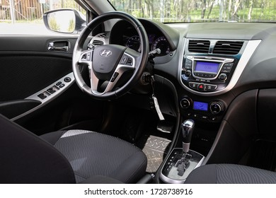 Novosibirsk/ Russia – May 02 2020: Hyundai Solaris, Dark car Interior - steering wheel, shift lever and dashboard, climate control, speedometer, display. Salon of a new stylish car