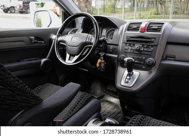Novosibirsk/ Russia – May 02 2020: Honda CR-V, Dark car Interior - steering wheel, shift lever and dashboard, climate control, speedometer, display. Salon of a new stylish car